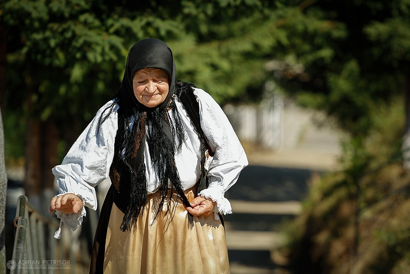 old woman going to church in a Sunaday morning